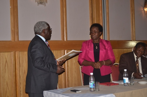 Above: Professor Mabel Imbuga, elected new RUFORUM Board receives the RUFORUM Constitution from the Outgoing Board Chair, Professor Levi Nyagura
