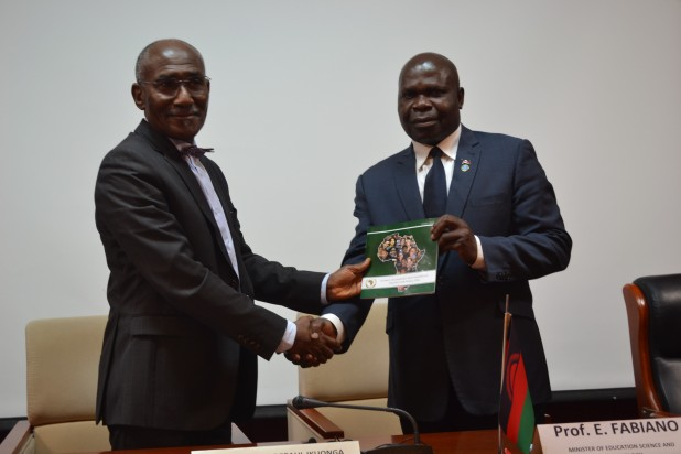 Right to left : H.E Dr. Martial De Paul Ikounga, the African Union Commissioner for Human Resource, Science and Technology, handing over the STISTA Booklet to Honourable Prof. Emmanuel Fabiano, Minister of Education, Science and Technology in Malawi during the opening ceremony.