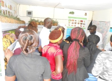 Dickson Otieno attends to customers at the AgriFresh kiosk in Egerton University