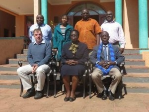 Otunga (seated middle) with some of the board members, LUANAR officials