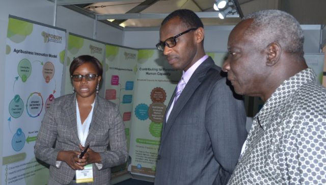 Above: Dr. Musafiri Malimba Papias, Minister of Education, Rwanda tours the RUFORUM Exhibition Stand at the FARA Seventh Agricultural Science Week, Kigali, Rwanda