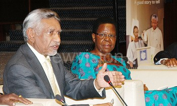 A South African freedom fighter, Mac Maharaj (left) speaks during the Nelson Mandela memorial lecture at Kampala Serena Hotel on July 15 2016. Right is the former minister of Agriculture, Victoria Ssekitoreko. PHOTO: Ronnie Kijjambu