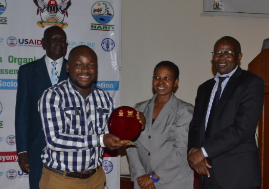 Above: Boris Alladassi receiving his award as Dr. Imeda (center) look on Prof. Bashasa (Right)